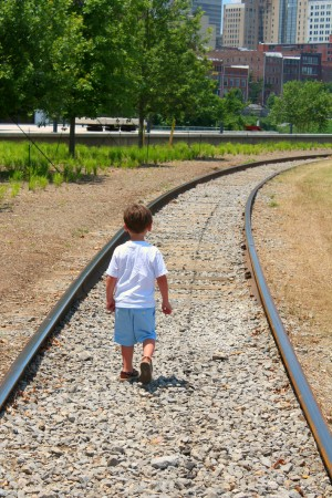 What little boy doesn't want to take a stroll on the tracks!