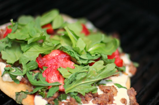 griled caprese pizza with arugula and italian sausage